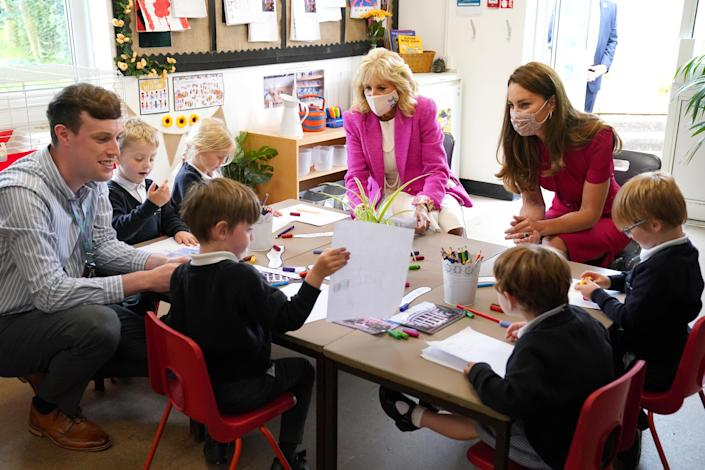 First lady Jill Biden and Catherine, Duchess of Cambridge talk with children in the school's Reception Class during a visit to Connor Downs Academy on June 11, 2021. / Credit: Aaron Chown / Getty Images