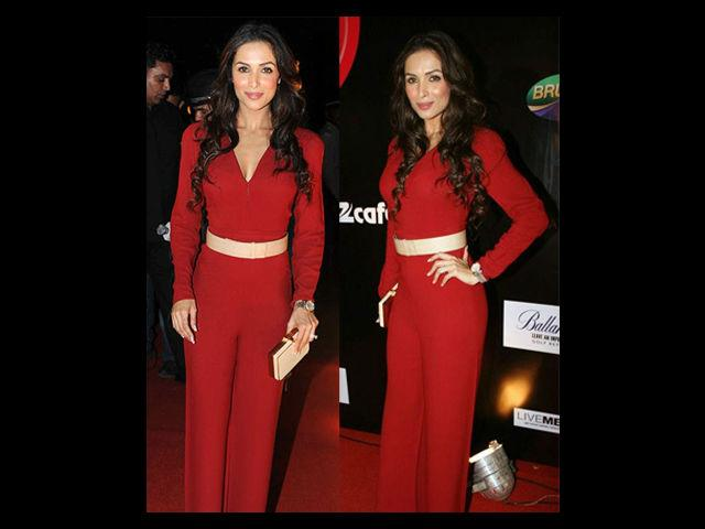 """<div class=""""heading03"""">Red Jumpsuit</div> <p><span style=""""text-decoration: underline;""""><strong>Celeb Example: Malaika Arora Khan </strong></span></p> <p>Petite, Malaika Arora Khan, looks her best in this jumpsuit. This covered dress certainly says that it is not just the skin show that sets fire to her sex appeal. Wear this red jumpsuit with belt a little high on the waist and like Malaika get your hair styled in curls and you are all set to rock the party.</p>"""