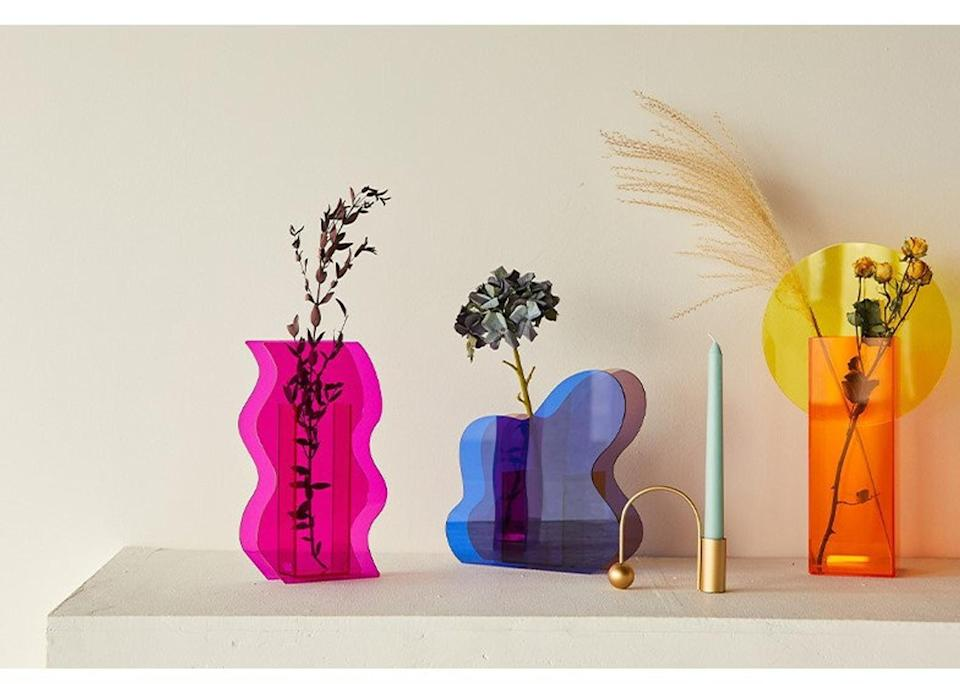 <p>These <span>Acrylic Vases</span> ($44 and up each) will embellish any surface.</p>