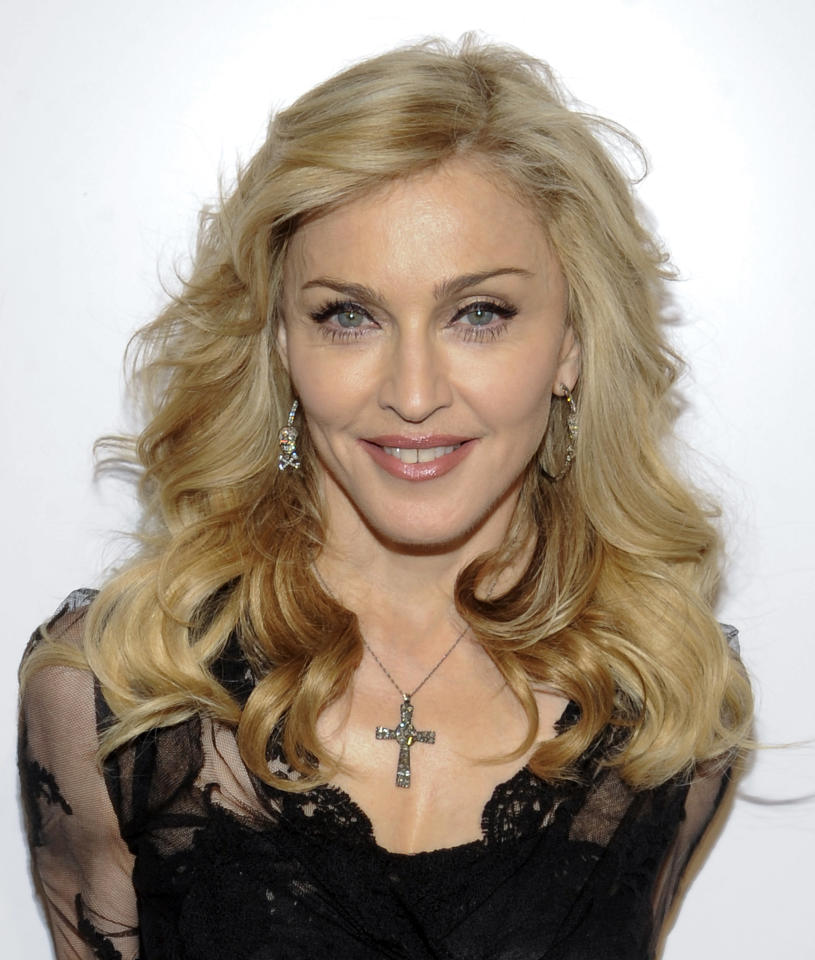 """Singer Madonna arrives at Macy's Herald Square to launch her new fragrance """"Truth or Dare By Madonna"""" on Thursday, April 12, 2012 in New York. (AP Photo/Evan Agostini)"""