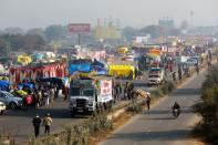 A view of a crowded highway as farmers protest against new farm laws at a state border in Shahjahanpur
