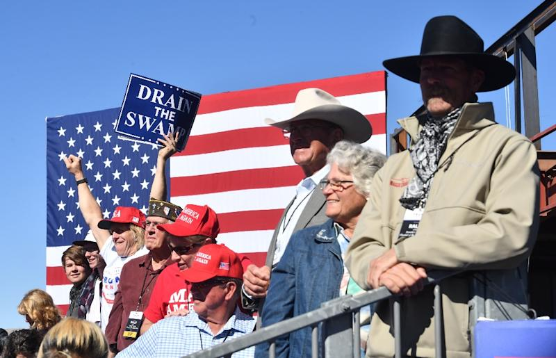 Trump supporters, like these at his recent rally in Elko, Nevada, regularly turn out to hear a man who has proven himself a formidable campaigner, if also, critics say, a dirty fighter (AFP Photo/Nicholas Kamm)