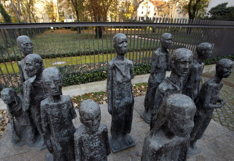"""A sculpture by German artist Will Lammert is pictured at the entrance to a Jewish cemetery and memorial in Berlin, Germany, Thursday, Oct. 31, 2013. Johannes Tuchel, director of Berlin's German Resistance Memorial Center says several documents, including a 1945 death certificate and a grave digger's testimony to police in 1963, make it """"clear-cut"""" to him that German Gestapo head Heinrich Mueller was buried near the Luftwaffe headquarters in the final days of the war. He says Mueller was later disinterred and buried with thousands others in a common grave in this Jewish cemetery destroyed by the Nazis. (AP Photo/Michael Sohn)"""