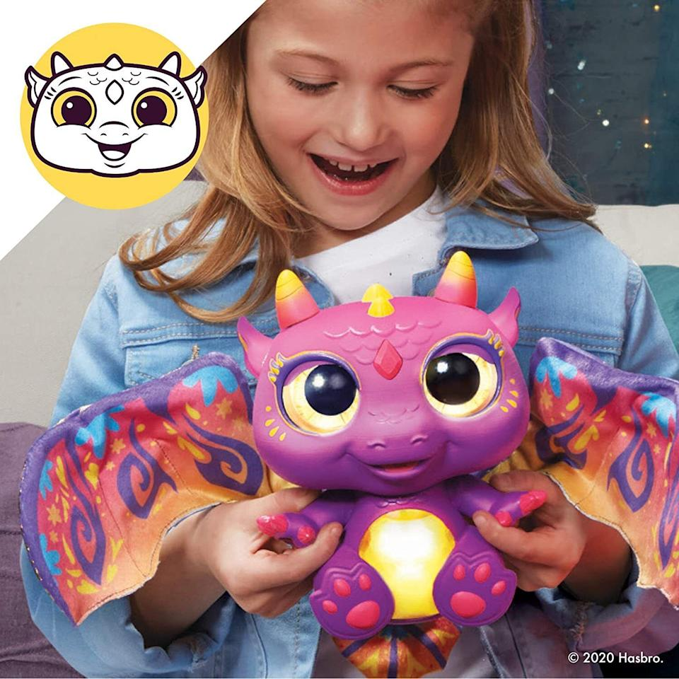 """It featuresflapping wings, eyes and a tummy that changes color depending on its mood. So yes, this dragon is indeed a mood.<br /><br /><strong>Get it from Amazon for <a href=""""https://www.amazon.com/dp/B083TCZFTC?tag=huffpost-bfsyndication-20&ascsubtag=5764152%2C25%2C40%2Cd%2C0%2C0%2C0%2C962%3A1%3B901%3A2%3B900%3A2%3B974%3A3%3B975%3A2%3B982%3A2%2C15993534%2C0"""" target=""""_blank"""" rel=""""noopener noreferrer"""">$28.42+</a> (available in two colors).</strong>"""