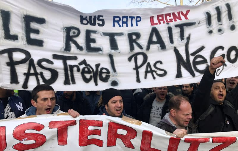 French labour union members and workers on strike attend a demonstration in Paris