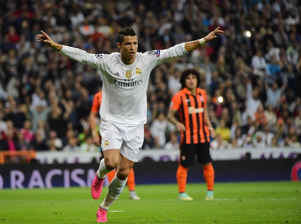 Paris face a fight with Real Madrid for supremacy with the Spanish giants underlining their credentials by brushing aside Shakhtar Donetsk 4-0 in the night's other game as Cristiano Ronaldo, pictured, netted yet another hat-trick (AFP Photo/Pierre-Philippe Marcou)