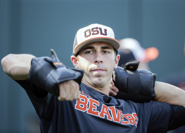 Oregon State pitcher Luke Heimlich works with weights during practice in Omaha, Neb., on June 15. (AP)