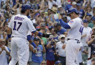 Chicago Cubs' Anthony Rizzo, right, celebrates with Kris Bryant after they scored on a two-run double by Jason Heyward during the seventh inning of a baseball game against the Cincinnati Reds in Chicago, Wednesday, July 17, 2019. (AP Photo/Nam Y. Huh)