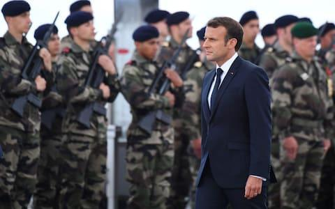 French President Emmanuel Macron inspects troops in Normandy - Credit: Damien MEYER / AFP