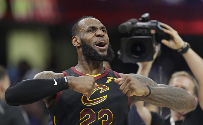 Cleveland Cavaliers' LeBron James celebrates after scoring the game-winning shot in the second half of Game 5 of an NBA basketball first-round playoff series against the Indiana Pacers, Wednesday, April 25, 2018, in Cleveland. The Cavaliers won 98-95. (AP Photo/Tony Dejak)