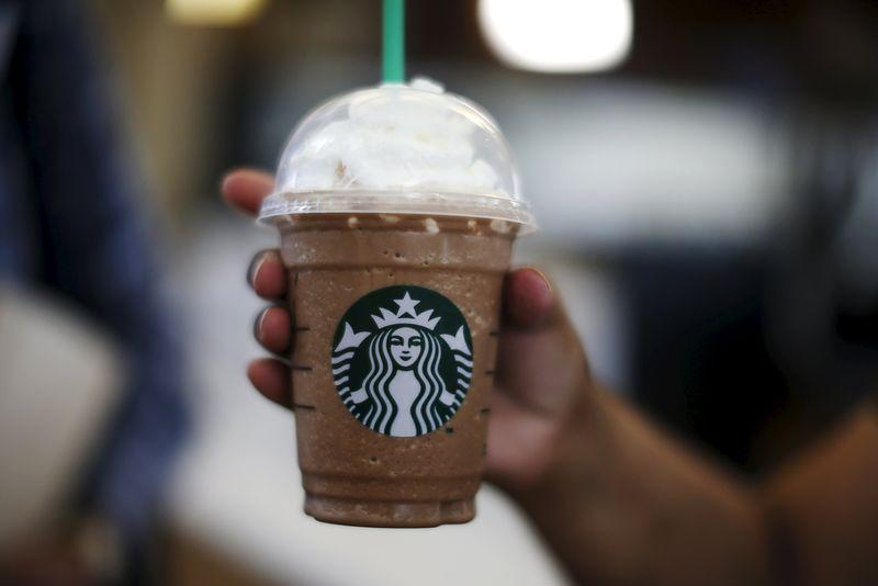 A woman holds a Frappuccino at a Starbucks store inside the Tom Bradley terminal at LAX airport in Los Angeles