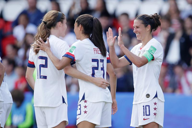 PARIS, FRANCE - JUNE 16: Carli Lloyd of USA Women Celebrates with Tierna Davidson of USA Women, Christen Press of USA Women during the World Cup Women match between USA v Chile at the Parc des Princes on June 16, 2019 in Paris France (Photo by Eric Verhoeven/Soccrates/Getty Images)