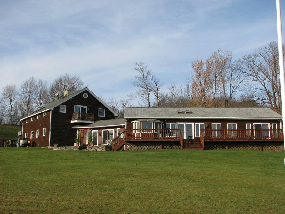 """<h2>The Catskills, New York</h2><br><strong>Location:</strong> Grahamsville, New York<br><strong>Sleeps:</strong> 4<br><strong>Price Per Night:</strong> <a href=""""https://airbnb.pvxt.net/WvV33"""" rel=""""nofollow noopener"""" target=""""_blank"""" data-ylk=""""slk:$174"""" class=""""link rapid-noclick-resp"""">$174</a><br><br>""""The perfect spot to experience the country! The perfect launching point for area skiing, hiking, and climbing! The private 1,500-square-foot home with a 672-square-foot deck overlooking 30+ acres with a lake and awesome country setting. House has a private entrance. A very romantic spot that is perfectly located in the Catskill Mountains for awesome day trips and having cookouts. Full kitchen and dining room — perfect for every occasion!""""<br><br><h3>Book <a href=""""https://airbnb.pvxt.net/WvV33"""" rel=""""nofollow noopener"""" target=""""_blank"""" data-ylk=""""slk:Romantic Private Home"""" class=""""link rapid-noclick-resp"""">Romantic Private Home</a><br></h3><br>"""