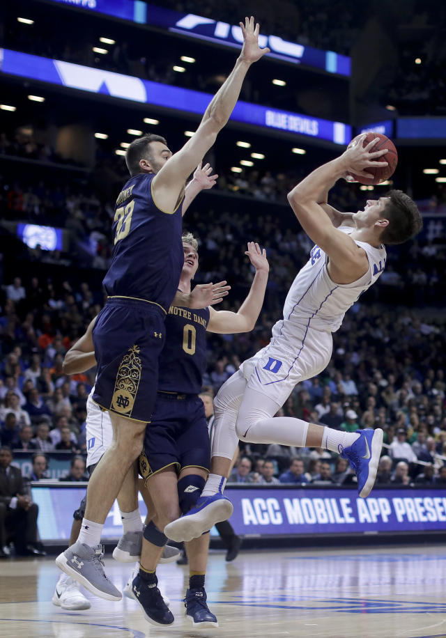 Duke guard Grayson Allen (3) shoots against Notre Dame forward John Mooney (33) and guard Rex Pflueger (0) during the second half of an NCAA college basketball game in the Atlantic Coast Conference men's tournament Thursday, March 8, 2018, in New York. (AP Photo/Julie Jacobson)