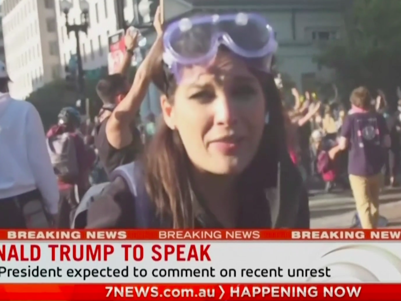 Reporter Amelia Brace reporting from protests in Washington DC, seconds after she and her cameraman were hit by riot plice