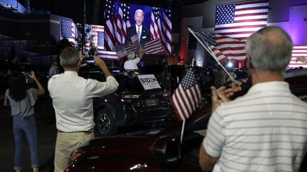 PHOTO: People listen to Democratic presidential nominee Joe Biden from a parking lot outside Chase Center in Wilmington, Del., Aug. 20, 2020. (Alex Wong/Getty Images)
