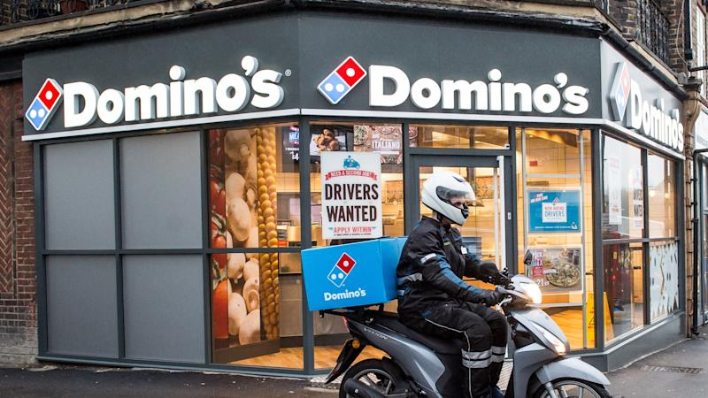 Domino's warns over writedowns as it posts sales hike