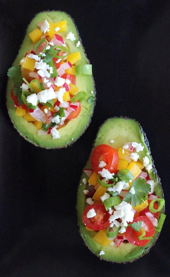 """<p>This quick and easy salad-stuffed avocado offers 60 percent of your recommended fiber for the day, not to mention <a href=""""https://www.popsugar.com/fitness/Eating-1-Avocado-Every-Day-Help-Weight-Loss-45664344"""" target=""""_blank"""" class=""""ga-track"""" data-ga-category=""""Related"""" data-ga-label=""""https://www.popsugar.com/fitness/Eating-1-Avocado-Every-Day-Help-Weight-Loss-45664344"""" data-ga-action=""""In-Line Links"""">avocado can help to reduce belly fat</a>. </p> <p><strong>Get the recipe:</strong> <a href=""""https://www.popsugar.com/fitness/Salad-Avocado-34773572"""" class=""""ga-track"""" data-ga-category=""""Related"""" data-ga-label=""""https://www.popsugar.com/fitness/Salad-Avocado-34773572"""" data-ga-action=""""In-Line Links"""">salad-stuffed avocado</a></p>"""