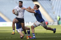 Scotland's Sean Maitland, left, is tackled by Italy's Marco Riccioni during the rugby union international match between Scotland and Italy at the Murrayfield stadium in Edinburgh, Scotland, Saturday, March 20, 2021. (AP Photo/Scott Heppell)