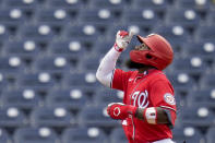 Washington Nationals' Josh Harrison points after hitting a solo home run during the third inning of a spring training baseball game against the Houston Astros Monday, March 1, 2021, in West Palm Beach, Fla. (AP Photo/Jeff Roberson)