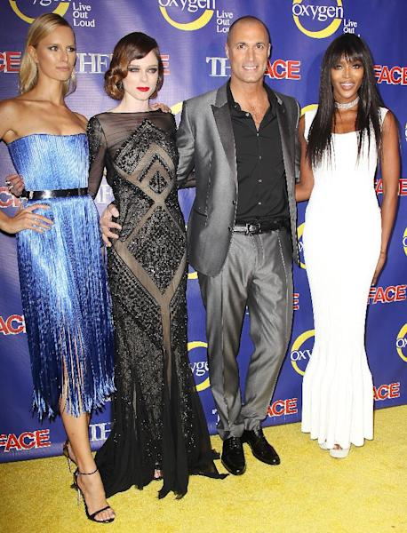 "This Feb. 5, 2013 photo released by Starpix shows models, from left, Karolina Kurkova, Coco Rocha and Naomi Campbell, right, pose with photographer Nigel Barker at the premiere of the Oxygen network series, ""The Face,"" in New York. Campbell, Rocha and Kurkova are coaches to aspiring models in a competition to find the next face of beauty retailer ULTA Beauty. The show, hosted by Barker, premieres on Feb. 12 at 9 p.m. EST on Oxygen. (AP Photo/Starpix, Kristina Bumphrey)"