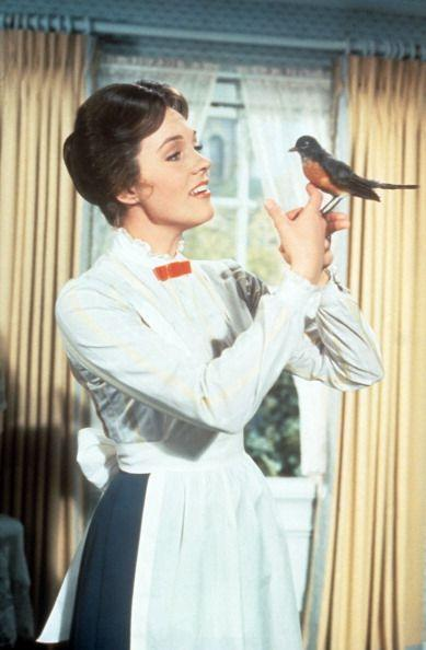<p>Andrews, who played the lead in Robert Stevenson's <em>Mary Poppins</em> is seen here holding a robin on her hand.</p>