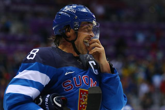 SOCHI, RUSSIA - FEBRUARY 21: Teemu Selanne #8 of Finland looks on after losing to Sweden 2-1 during the Men's Ice Hockey Semifinal Playoff on Day 14 of the 2014 Sochi Winter Olympics at Bolshoy Ice Dome on February 21, 2014 in Sochi, Russia. (Photo by Martin Rose/Getty Images)