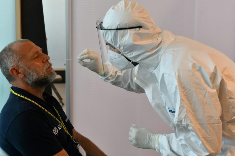 A crew member of the MSC Orchestra cruise ship undergoes a swab test