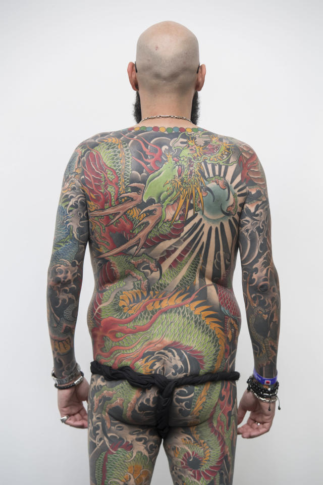 <p>A visitor displays his full body tattoo at the London Tattoo convention at Tobacco Dock on Sept. 23, 2017 in London, England. (Photo: James D. Morgan/Getty Images) </p>