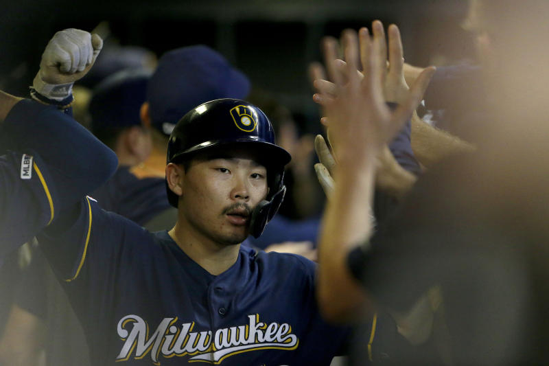 Milwaukee Brewers' Keston Hiura is congratulated in the dugout after hitting a two-run home run during the first inning of a baseball game against the Pittsburgh Pirates, Saturday, Sept. 21, 2019, in Milwaukee. (AP Photo/Aaron Gash)