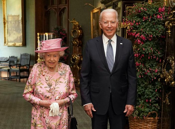 Queen Elizabeth II with US President Joe Biden in the Grand Corridor during their visit to Windsor Castle on 13 June, 2021 in Windsor, England. Queen Elizabeth II hosted US President, Joe Biden and First Lady Dr Jill Biden at Windsor Castle. The President arrived from Cornwall where he attended the G7 Leader's Summit and will travel on to Brussels for a meeting of NATO Allies and later in the week he will meet President of Russia, Vladimir Putin (Getty Images)