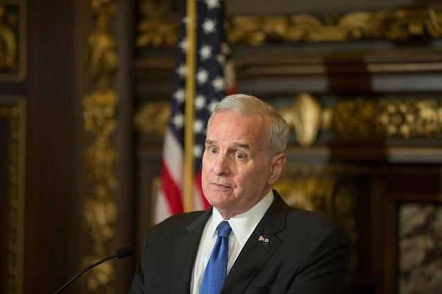 <p>Minnesota Gov. Mark Dayton pauses as he speaks about latest developments in the shooting of Australian Justine Damond, at the capitol Wednesday, July 19, 2017 in St. Paul, Minn. (Photo: Jerry Holt/Star Tribune via AP) </p>