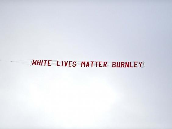 The banner is pictured flying above the Etihad Stadium (PA)