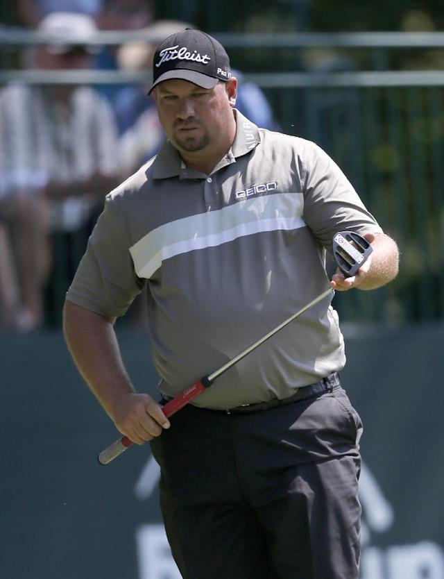 Brendon de Jonge looks over his putt on the sixth hole during the first round of the 2014 John Deere Classic golf tournament at TPC Deere Run in Silvis, Ill., Thursday, July 10 2014. (AP Photo/Charles Rex Arbogast)