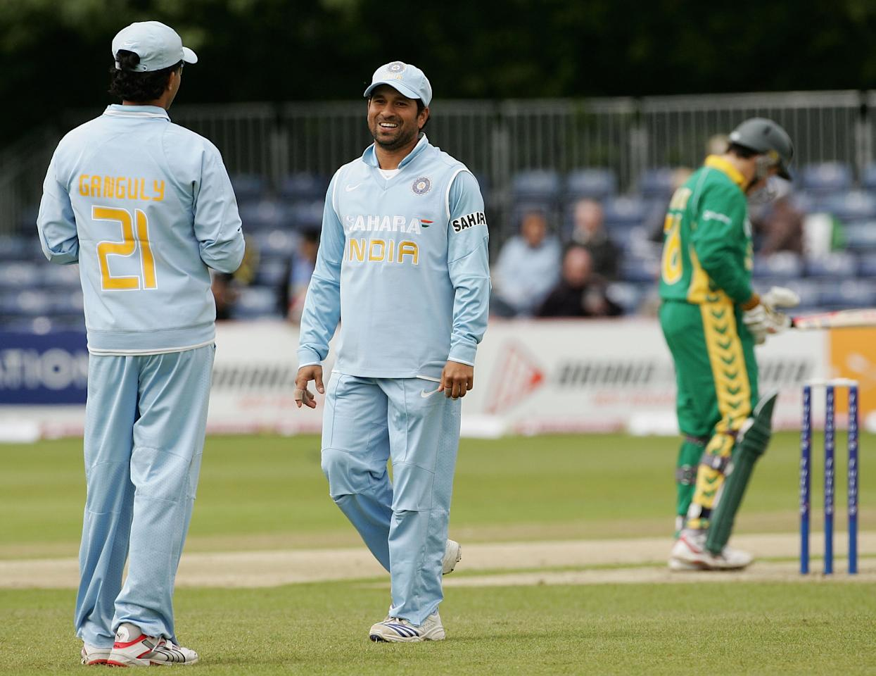 BELFAST, UNITED KINGDOM - JUNE 29:  Sachin Tendulkar (C) of India shares a laugh with team mate Sourav Ganguly during the second One Day International match between South Africa and India at the Civil Service Cricket Club in Stormont on June 29, 2007 in Belfast, Northern Ireland.  (Photo by Hamish Blair/Getty Images)