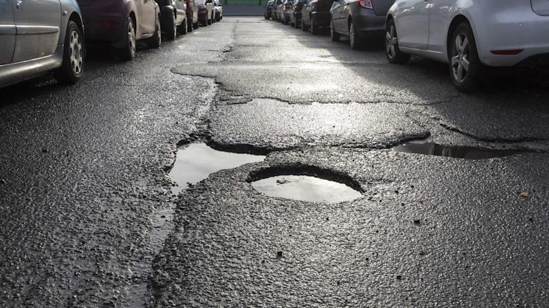 Potholes in the middle of narrow one way road