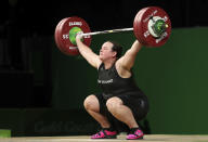 FILE - In this April 9, 2018 file photo, New Zealand's Laurel Hubbard lifts in the snatch of the women's +90kg weightlifting final at the 2018 Commonwealth Games on the Gold Coast, Australia. Hubbard will be the first transgender athlete to compete at the Olympics. Hubbard is among five athletes confirmed on New Zealand's weightlifting team for the Tokyo Games. (AP Photo/Mark Schiefelbein,File)