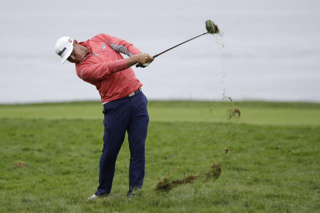 Gary Woodland hits from the rough on the 11th hole during the final round of the U.S. Open Championship golf tournament Sunday, June 16, 2019, in Pebble Beach, Calif. (AP Photo/Marcio Jose Sanchez)