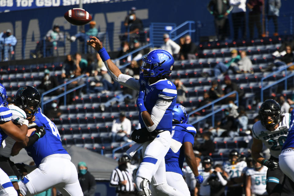 Georgia State quarterback Cornelious Brown IV passes against Coastal Carolina during the first half of an NCAA football game Saturday, Oct. 31, 2020, in Atlanta. (AP Photo/John Amis)
