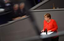 FILE PHOTO: German Chancellor Angela Merkel addresses the lower house of parliament Bundestag, in Berlin