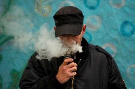 FILE PHOTO: A man poses for a picture, as he vapes at home in La Paz,