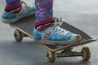"""This young girl is wearing sneakers from the Disney movie """"Frozen"""" as she skateboards (AFP/Miguel SCHINCARIOL)"""