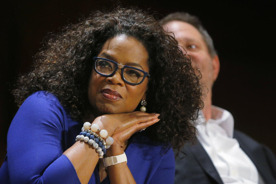 Entertainer Oprah Winfrey listens to the speakers before accepting a W.E.B. Du Bois Medal at the Hutchins Center Honors at Harvard University in Cambridge, Massachusetts September 30, 2014.    REUTERS/Brian Snyder    (UNITED STATES - Tags: EDUCATION SOCIETY ENTERTAINMENT)