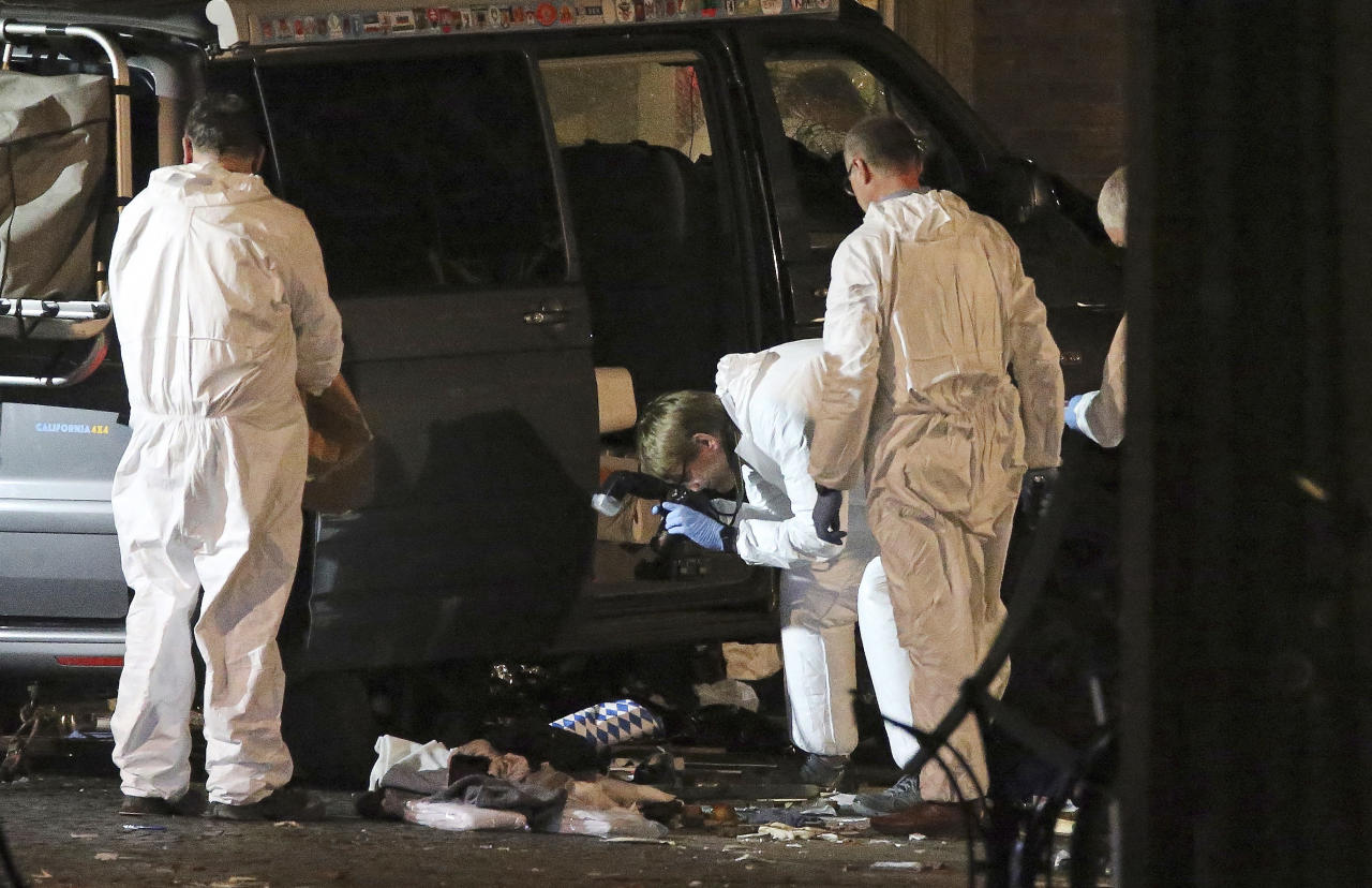 <p>Forensic experts work on the scene in Muenster, western Germany, Sunday, April 8, 2018 where a van crashed into people drinking outside a popular bar on Saturday afternoon, April 7, 2018. (Photo: David Young/dpa via AP) </p>