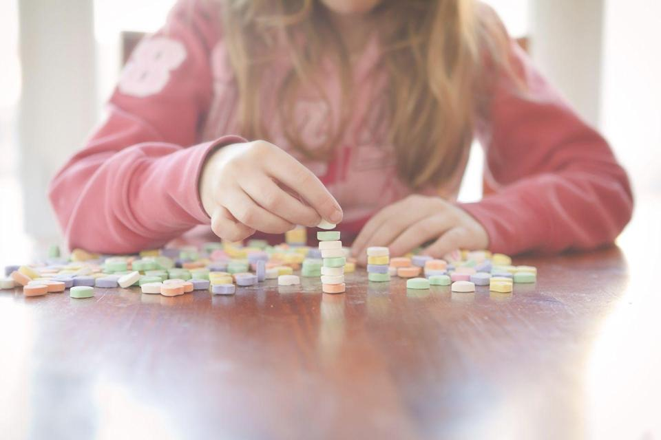 """<p> These are timed challenges that test kids' candy skills. An easy one is to see how many candy hearts they can stack up in 60 seconds. If you want to make it more challenging, give the kids chopsticks and ask them to pick up hearts one at a time and drop them in a mason jar. Speed counts! </p><p><em><a href=""""https://teachmama.com/minute-to-win-it-class-party/"""" rel=""""nofollow noopener"""" target=""""_blank"""" data-ylk=""""slk:Get the tutorial at Teach Mama »"""" class=""""link rapid-noclick-resp"""">Get the tutorial at Teach Mama »</a></em></p>"""