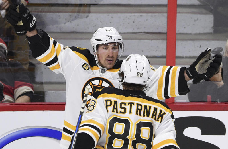 Boston Bruins left wing Brad Marchand (63) celebrates his game-winning goal with teammate David Pastrnak during the third period of the first round of NHL Stanley Cup playoff hockey action in Ottawa on Wednesday, April 12, 2017. (Sean Kilpatrick/The Canadian Press via AP)