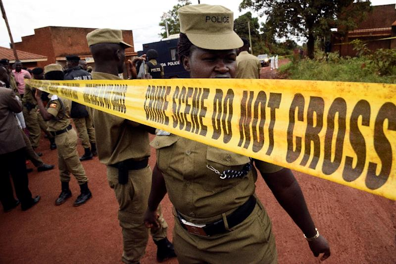 Uganda's police officers cordon off the scene where senior police officer Andrew Felix Kaweesi was murdered in a Kampala Suburb on March 17, 2017