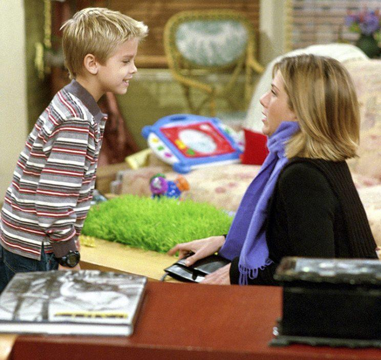 Cole Sprouse as Ben Geller and Jennifer Aniston as Rachel Green in