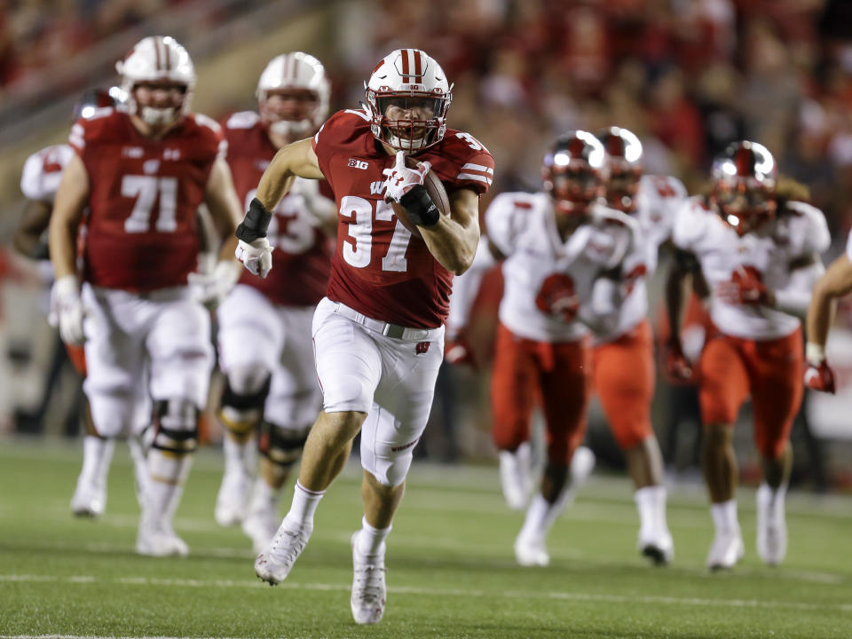 FILE - In this Aug. 31, 2018, file photo, Wisconsin running back Garrett Groshek (37) heads to the end zone with a 42-yard touchdown against Western Kentucky during the second half of an NCAA college football game in Madison, Wis. Groshek ran for 194 yards on 42 carries and caught 29 passes for 289 yards last season. (AP Photo/Andy Manis, File)