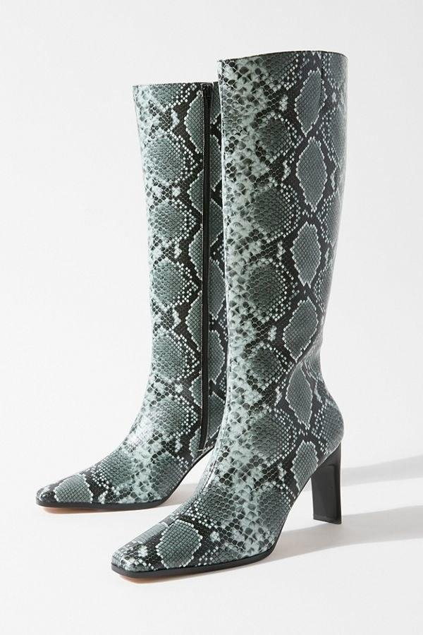 """$98, Urban Outfitters. <a href=""""https://www.urbanoutfitters.com/shop/uo-mila-heeled-tall-boot?category=shoes-for-women&color=015&type=REGULAR"""" rel=""""nofollow noopener"""" target=""""_blank"""" data-ylk=""""slk:Get it now!"""" class=""""link rapid-noclick-resp"""">Get it now!</a>"""